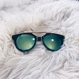 Accessories - Black sunglasses with blue green lens